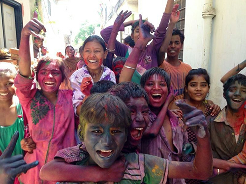 Happy children with colour on their faces. Holi festival. Photo: Jana Schwarz.
