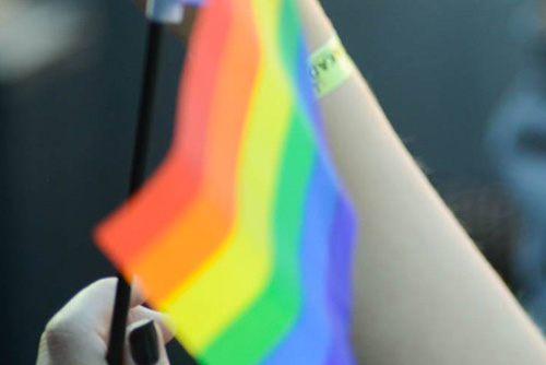 Hand with rainbow flag