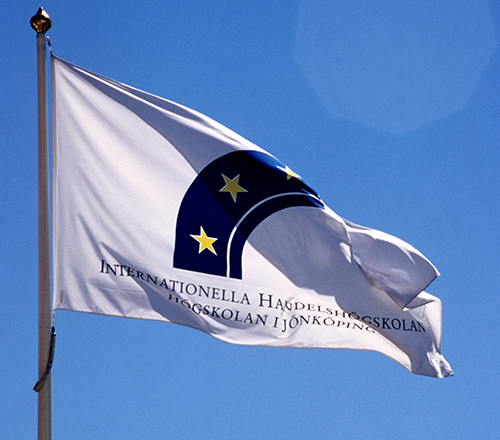 A flag with the JIBS logotype used from 1994 to 2015