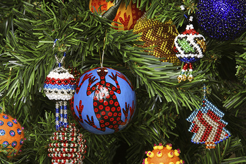 Close up of colorful bulbs in christmas tree